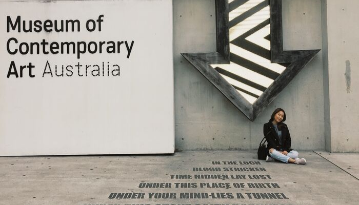 CDU student Pattarawadee Chatleelawat sits in front of the Museum of Contemporary Art in Sydney