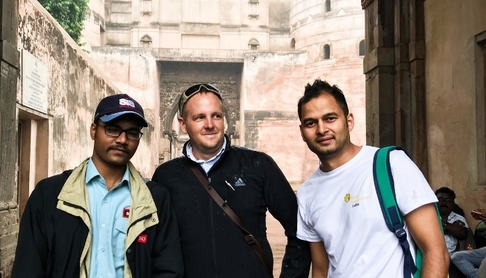 CDU student Dion Morrow with two peers in India