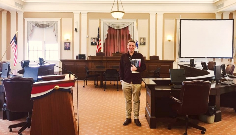 CDU student Paul Larder in a courtroom at Harvard Law School