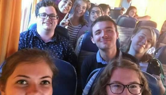 Image of William and his exchange friends on a bus