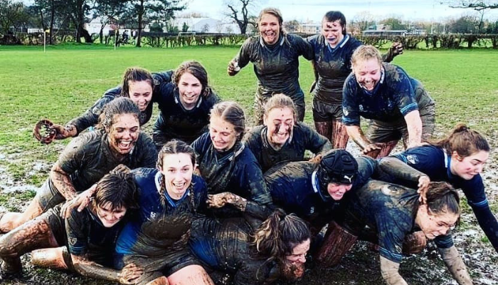 CDU student Lucy Lockhart on the rugby field with her teammates