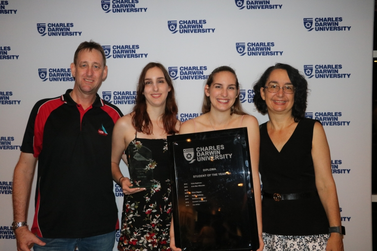 Zoe's family: Her dad Mark, her twin sister Peta and her mum Kathryn, as Zoe holds her award for Diploma Student of the Year