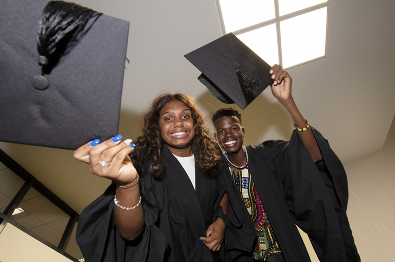 Students Nancy Holtze and Makuer Akol celebrate graduating from the Team Aspire program