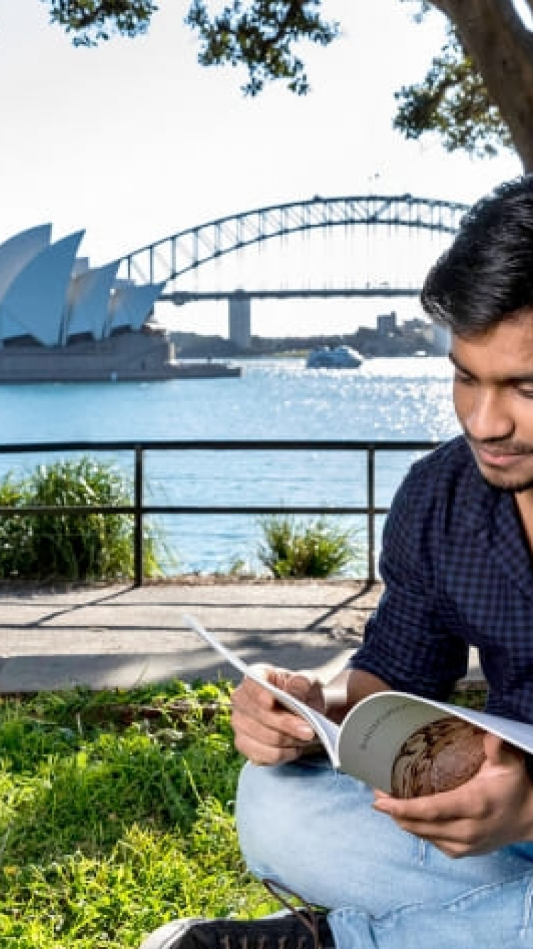 Student studying near Sydney Harbour