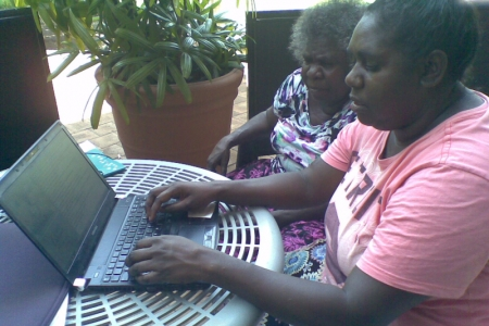 Indigenous woman on a computer