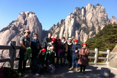 Students posing in front of a mountian in China