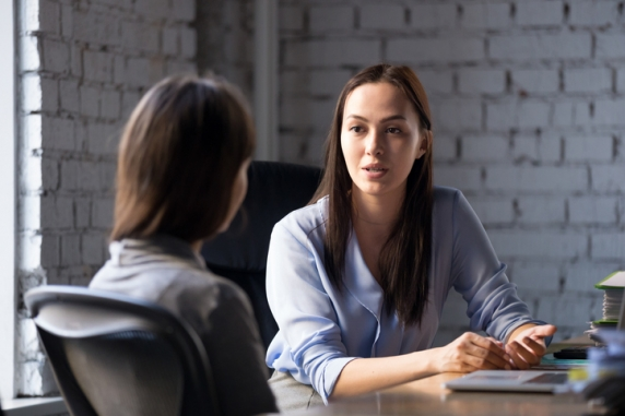 Professional female advisor speaking to a client