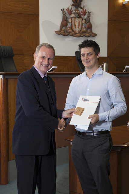 Attorney-General, the Honourable John Elferink MLA and the Attorney-General's Medal recipient Joel Cockerell