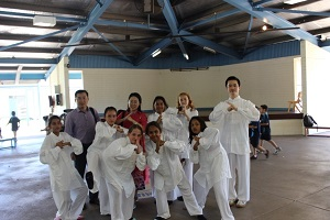 Tai Chi students together with teacher Mr Fala Chen give salute