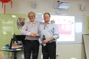 CI Director Professor Martin Jarvis present gift to the Principal of Nightcliff Primary School