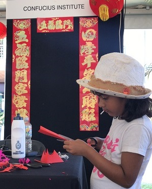 Children learn how to do Chinese Paper cutting