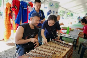Visitors experience Chinese Traditional Instrument