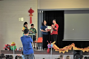 CI donate Chinese language textbook to Anula Primary School