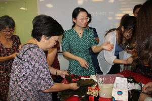 Audience making rice dumplings together