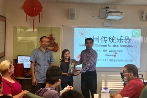 CI Chinese Director Hua Wang sent gift to student representative from Nightcliff Primary School