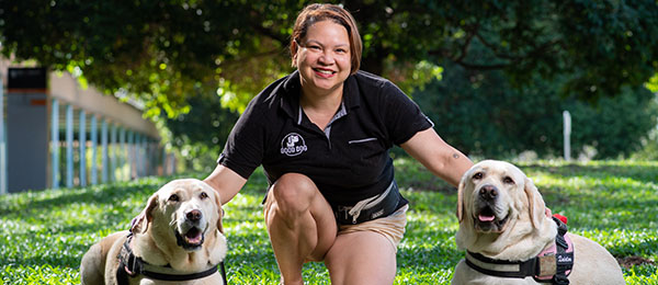 Good Dog Animal Assisted Intervention superstars Roxy and Quinton make a comforting presence with their trainer Hannah Taino-Spick.