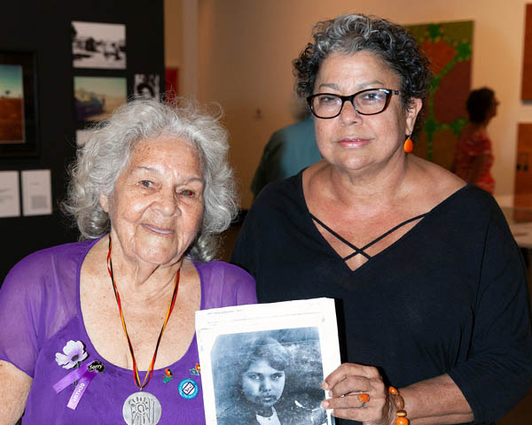 Kathy Mills and Dr Wendy Ludwig, with a photograph of Wendy's mother and Kathy's sister who was among the stolen generation