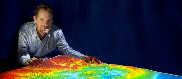Charles Darwin University Researcher, Rohan Fisher, with a 3D mapping projection
