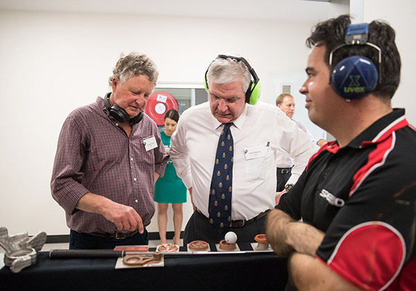 Richard Young, Professor Raoul Mortley and Sylvain Laversanne look at the flywheels created during the demonstration