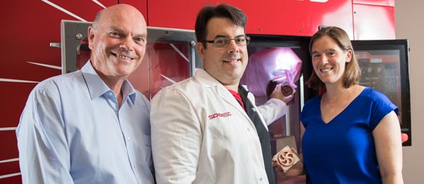 At the first run of the 3D metal printer are (from left) Deputy Vice-Chancellor Research and Research Training Professor Lawrence Cram, LightSPEE3D Chief Technical Officer Steven Camilleri and Director of the Advanced Manufacturing Alliance Dr Rebecca Murray