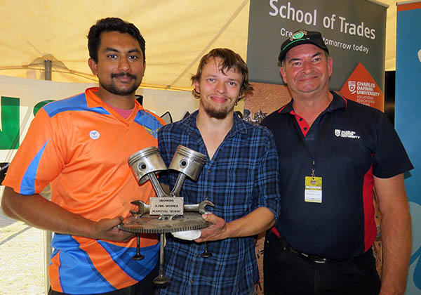 Shannon's Flying Spanners winners Eldhose Thomas and Alex Riley receive their trophy from Automotive Trainer Rob Tucker