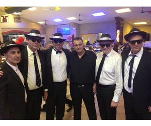 "NT Chief Minister Adam Giles, Deputy Chief Minister Dave Tollner, Minister for Multicultural Affairs Peter Styles and Department of Foreign Affairs and Trade Director Lorenzo Strano attend in ""Blues Brothers"" costume at the Apokries celebration"