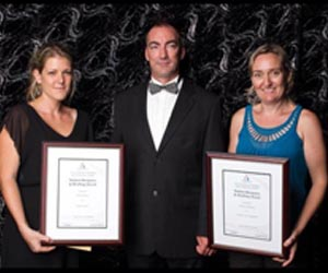 School of Trades head, Justin Busse (centre) with winners of the Excellence in Student Building Design and Drafting award Helena Hainz and Melissa Robinson