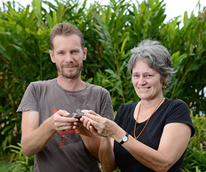 Senior Research Fellow Dr Bronwyn Myers holds samples of manganese ore from Kupang with Research Fellow Rohan Fisher