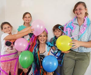 CDU student Deanna Shepherd (centre) with her children (from left) Madison, Abbey, Sam and Chelsea