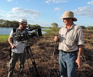 Lecturer Dan Baschiera in action for National Geographic cameraman and field director Cian O'Cleary in Kakadu