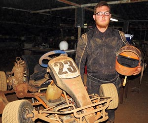 Automotive student Adem Mahomet packs away his go kart after the recent night meeting in Alice Springs