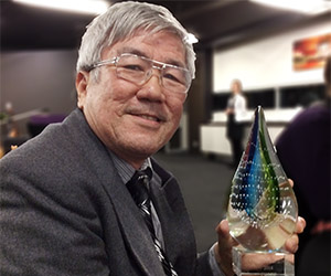 Commercial cookery lecturer TY Lee with his Legends trophy