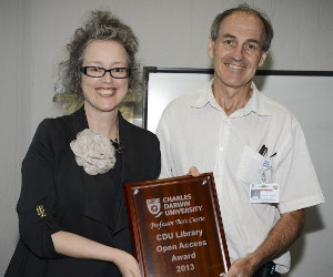 Pro Vice-Chancellor Faculty of Law, Business, Education and Arts Professor Giselle Byrnes presents 2013 CDU Library Open Access Award winner Professor Bart Currie with his award