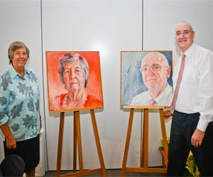 CDU Chancellor Her Honour the Honourable Sally Thomas AC and former Vice-Chancellor Professor Barney Glover with their portraits by artist Danelle Bergstrom