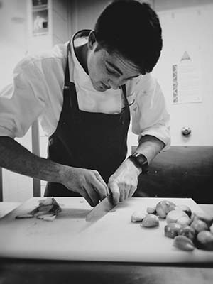 Commercial Cookery student Jayden Cohen in the kitchen where meals for the Royal couple were prepared