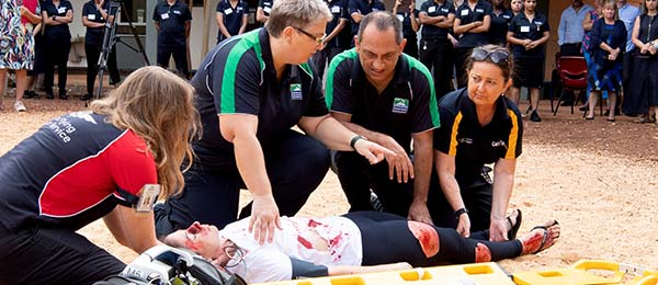 Aeromedical Retrieval faculty members demonstrate their expertise in preparing an injured patient for aeromedical retrieval at Charles Darwin University's launch of its new postgraduate courses. From left, Associate Professor Mardi Steere, Senior Lecturer Nadine Tipping, Associate Professor Peter Archer and Senior Lecturer Jodie Mills