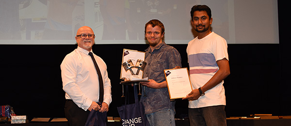 From left: School of Trades Head Roy Brandner congratulates Flying Spanners winners Alex Riley and Eldhose Thomas