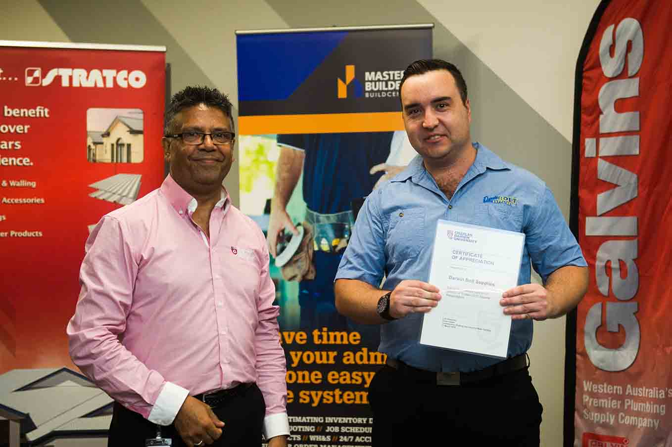Luis Espinoza presents Lewis Knibbs from Darwin Bolt Supplies with a Certificate of Appreciation for major sponsorship and ongoing support to CDU's plumbing and carpentry department