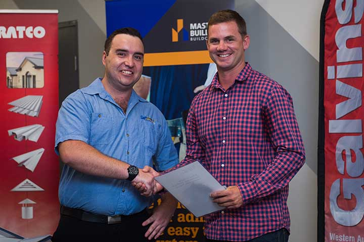 Major sponsor Darwin Bolt Supplies Lewis Knibbs presents Most Outstanding First Year Apprentice of the year in Certificate III Plumbing Services to Scott Richards
