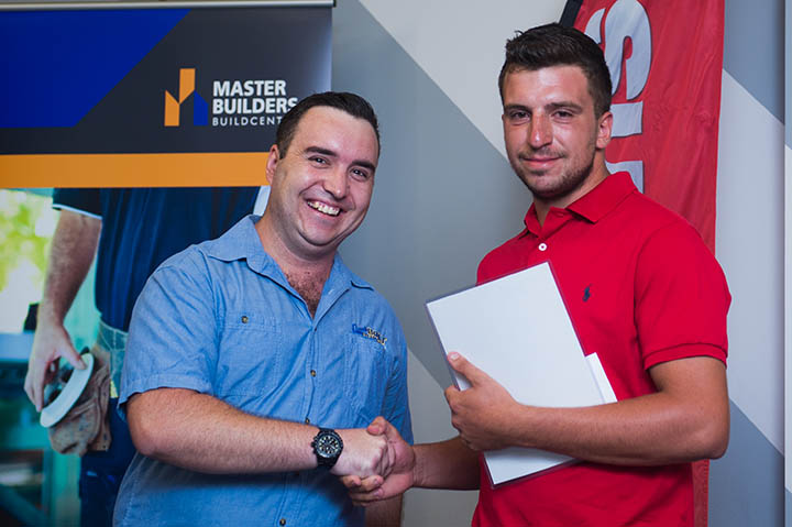 Major sponsor Darwin Bolt Supplies Lewis Knibbs presents the joint Most Outstanding Second Year Apprentice of the Year in Certificate III Plumbing services to Themelis Mousellis