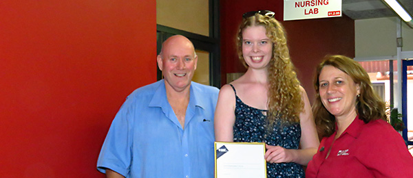 Director Central Australia Lyle Mellors (left) with award recipient Ashley Smith and nursing lecturer Robin Cross