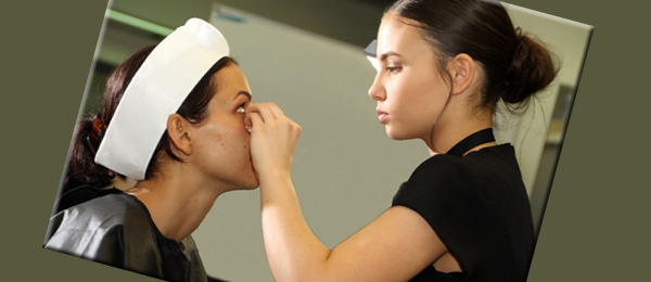 Diploma of Beauty student Ella Adami (right) applies make up to a client