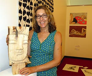 Arts lecturer Suzi Lyon curates the Beyond Belief exhibition in Alice Springs