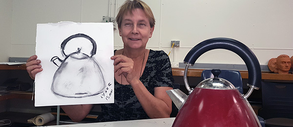 Lynne Wastell with her first drawing as a Visual Arts student