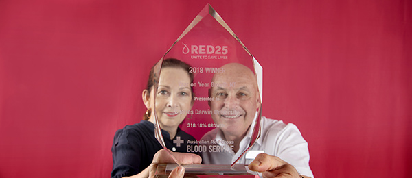 Media and Communications Director Robyn McDougall receives the trophy from Australian Red Cross Blood Service Regional Partnerships Manager (SA/NT) David McFarlane