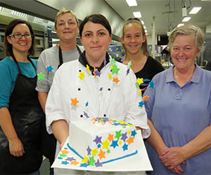 Cake decorator Hayley Tobin (centre) with graduates from the exploding cake class