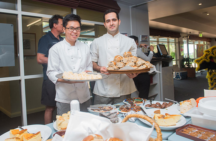 Dominique Cabral and Alexander Arustamov display desserts of vanilla bean ice cream and freshly baked hot cross buns