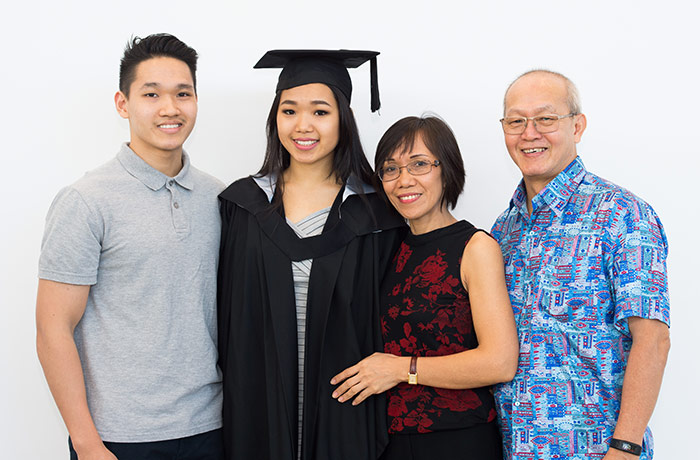 Bachelor of Accounting graduate Xuelian Angie Ng with her brother, Antonie Ng, and parents Marie and William Ng