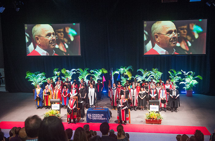 Graduation begins on the stage of the Darwin Convention Centre