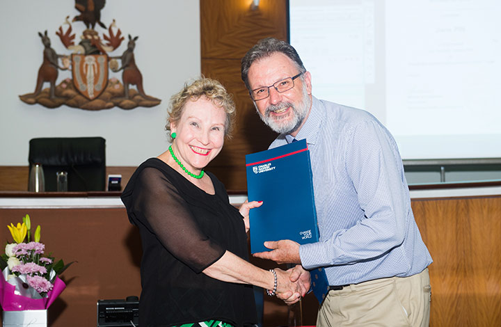 Professor Peter Kell presents the Award for Outstanding Academic Achievement in Constitutional Trusts to student Jane Pitt.